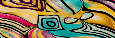 Background texture, drawing. Silk fabric. Cloth with bright stripes of colored patterns, abstract image. Stock Photo