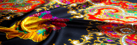 Background texture, drawing. Silk fabric. Fabric with bright patterns of yellow and red colors, Indian fabric, silk fabric around the yard, printed silk, printed fabric Sanganery