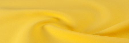 heavy silk Yellow fabric. 100% silk fabric is thick, but elastic and has a natural woven texture of the surface that will be combined with any pattern or motif that you might want to combine it with
