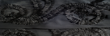 Texture, background, pattern. Black silk fabric. With sewn patterns. Elegant and eclectic, turn this gray abstract printed silk georget into something incredible! Violet-gray, black, Stock Photo