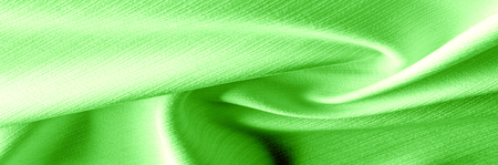 Texture. Green salad Emerald jacquard fabric. brings us a silk organza with a touch of texture. Peacock green, its drawing very few password lines. You will find an easy average weight, bright design Stock Photo