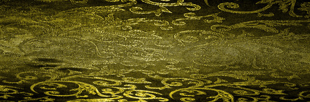 silk cloth Royal monogram. Yellow is dark. This is a black silk velvet with a royal gold seal, creating a negative space patterned picture. Light weight, great for design. Stock Photo