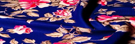 Background texture, pattern. Fabrics of blue color with painted roses, Polyester crepe. A clogged, textured surface with a dry hand feeling. Soft drapery. Suitable for design