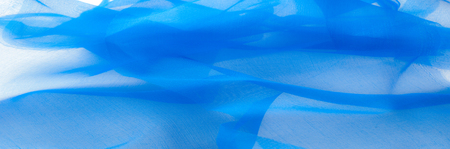 Soft focus. texture, pattern. The fabric is blue. silk fabric is transparent. This is very important for all design studios. This finish is a flexible type of polyester mesh and any garment.