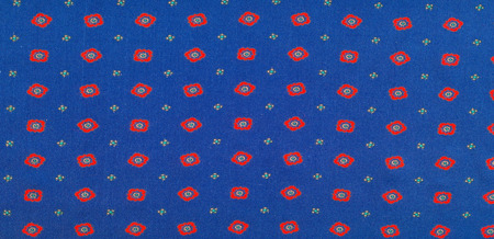 texture of the silk fabric with an abstract pattern, a pattern of tiny red quadrangles. Standard-Bild