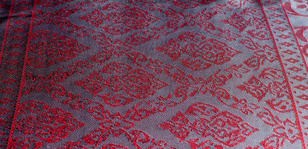 The texture of cotton fabric, with red painted elephants, made in India