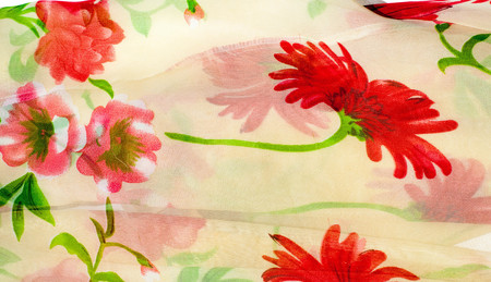 texture of silk fabric. background. Beige with red flowers. Silk floral fabric with red peony,