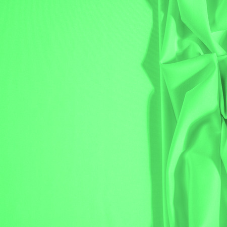 Texture. Background. Template. Cloth - silk green. Known extravagance, this Green silk taffeta is nothing more than a word. Luminous light green fabric is a crispy hand, inherent in tafeta. Imagens