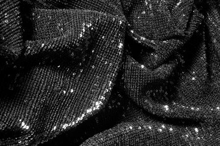 Black fabric with paillettes Make a dazzling debut  this Black Baby Sequined  The coating of the strength of the continuous mesh remains a dense arrangement of circular glitters for the entire coating