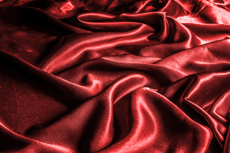 texture, pattern. silk fabric red, metallic thread. metallic sheen. Introducing a dazzling metallic abstract jacquard. A luxurious and textured, metallic thread provides an unrivaled shiny brilliance