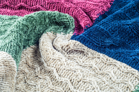texture, background. pattern. Sweater winter clothes. a knitted garment, usually with long sleeves, worn over the upper body.ersey, pullover, slip-on, slip-over