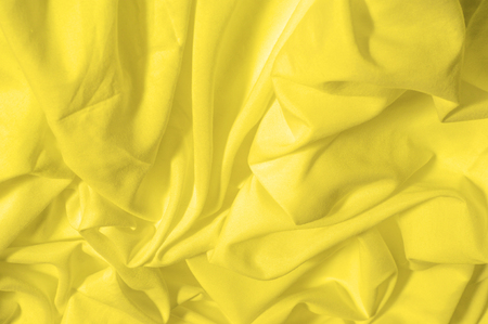 Soft focus. texture, pattern. fabric silky yellow, solar Golden yellow silk feil. Like the body to the taffeta, it has a smooth arm that creates a subtle sheen. Thin and lighter weight,