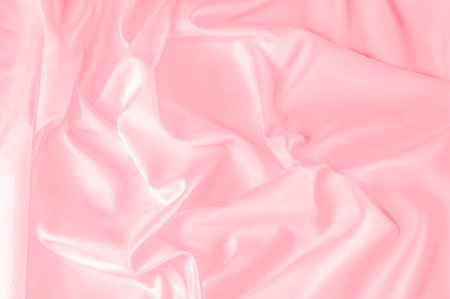 background texture. silk fabric pink. This Powder Pink Silk Woven gives an aura of a springtime romance. Its gentle tone presents a satin-like face making it smooth and luminous.