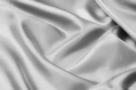 Miękka tekstura białej tkaniny jedwabnej. Wyglądaj absolutnie idealnie w tej podwójnej satynie z jedwabiu i bawełny. Ta kolekcja atlasów jest niesamowicie gładka w dotyku. Zatwierdzam twój wybór. Świetny projekt