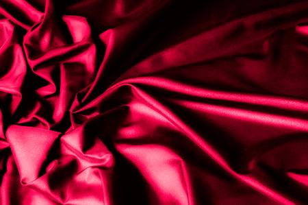 Texture, background, pattern. Dark red silk fabric. Silk satin Fabric  Silk square bridal fabric.