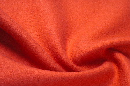 Texture, background, pattern. Vicuña fabric is a luxurious rarity. Drape of monochromatic red color