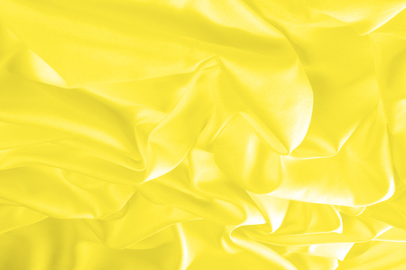 Soft focus. texture, pattern. fabric silky yellow, solar Golden yellow silk feil. Like the body to the taffeta, it has a smooth arm that creates a subtle sheen. Thin and lighter weight, Imagens