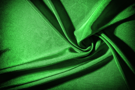 Texture, background, pattern. cloth silk green. This green flower silk crepe de China is here to charge your design! It is a subtle shine when its uplifting drape moves and falls.