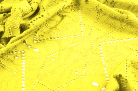 texture, pattern. Cloth is yellow dense with perforated holes. Perforated with a delightful design, ripe for conversation. Providing an extremely soft surface texture along with flexible drapery, Stok Fotoğraf