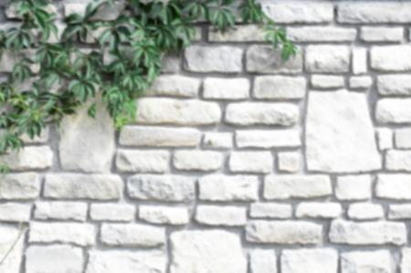 Textuurachtergrond, patroon. De muur is van steen. Architectuur. Bouw, huis omheining. Zandstenen kasseien Stockfoto