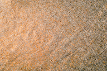 Background texture, pattern. Dense cotton fabric with gold color. Stop the presses! We at Mood just received the coolest material in the world  an outstanding Browned Gold Color Reflective Fabric. Stock Photo