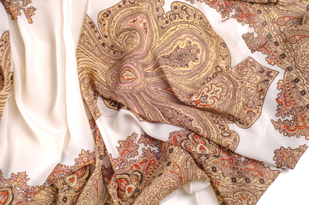 texture, pattern. White silk fabric with a brown pattern. A female scarf in Indian design. a drawing of any other name can smell like sweet, but will not look as gorgeous as these patterned silks. 写真素材 - 120224210