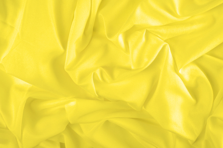 Soft focus. texture, pattern. fabric silky yellow, solar Golden yellow silk feil. Like the body to the taffeta, it has a smooth arm that creates a subtle sheen. Thin and lighter weight, 写真素材 - 120224229