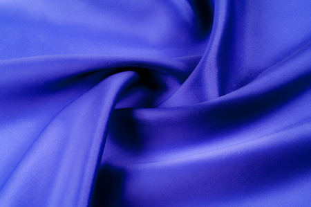Soft focus. texture, pattern. fabric silk blue. Inside, elegantly with blue midnight light, add this Italian Silk Crepe Back Satin to your design. Silky smooth with a luminous satin face