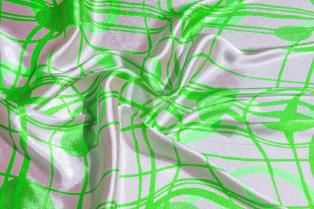 Silk. The fabric is green in steel, the fabric is colored with green lines. Fix it with this exciting patchwork ! This material is slightly transparent, pleasantly soft and contains an elegant drapery Stock Photo