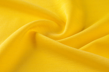 Texture, background, pattern. Yellow jacquard fabric. Providing both a texture and a thin structure, they demonstrate a quilted hand in a wave of geometric design. Jacquard has a transparent opacity Stok Fotoğraf