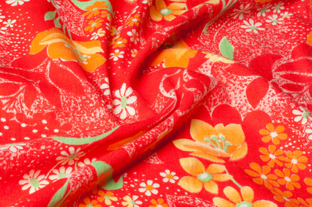 Texture, background, pattern. Cotton cloth of red color, On the fabric are painted flowers yellow white Stock fotó - 120372837