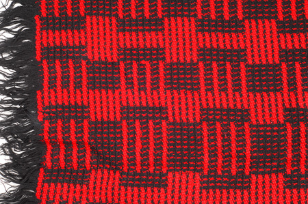 Texture, background, pattern. Soft warm cozy scarf in red cage
