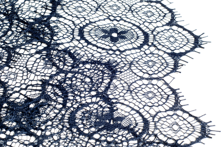 texture, background, pattern. lace fabric. dark blue color. Elegant and ready for a mesmerizing debut, this evening blue floral embossed lace was made from the dream of a midnight garden.
