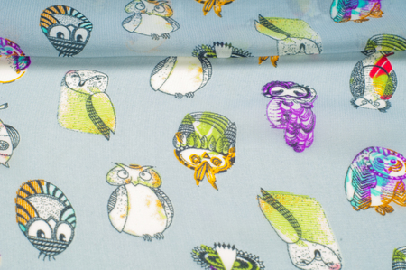 texture, pattern. cloth for children pattern silk. Painted owls, bright comics