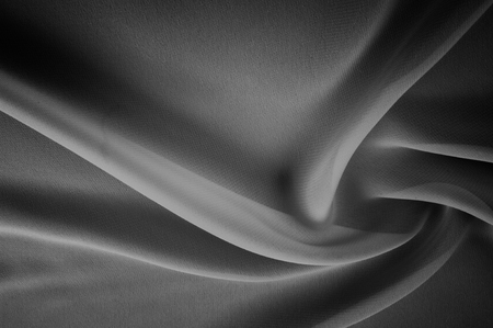 silk fabric is transparent, black and white. this material contains a coarser texture, a more rigid drapery and a slight peeping effect. We recommend using this fabric for your convenience.