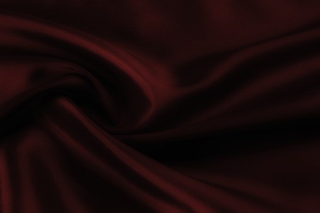 Soft focus. texture, pattern. cloth silk red. it is a light smooth drape that promotes movement. Thin and light, add a delicious piece to your autumn-winter design. Transparent, if you raise to light,