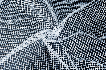 fabric, background texture. White silver mesh fabric, with a woven metallic thread. Silver fashion mesh! Flickering beads add texture and shine to the piece. Stock Photo