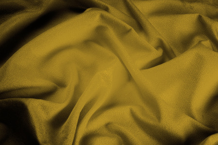 silk fabric is transparent, mustard, yellow. Chandeliers, light and abundant - all the characteristics of this fantastic fabric that you do not want to miss! Here we have a glamorous, light mustard