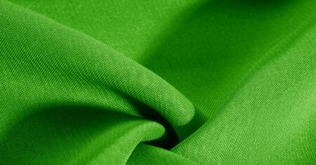 texture, background, pattern, green salad, silk fabric This very lightweight fabric made of artificial silk has a pleasant sheen. Ideal for adding elegance to your internet decor projects. Stock Photo