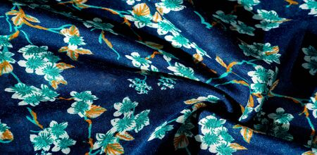 Texture, background, pattern, fabric blue with green colors of flowers. Your possibilities are endless! Courage and success will be yours!