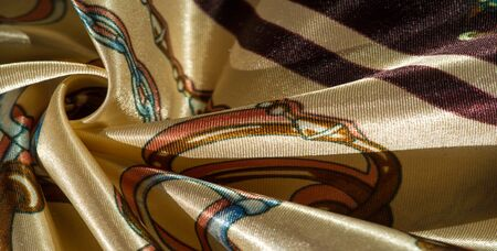 Texture, background, pattern, decorative silk fabric. This collection of silk fabrics with digital printing from RJR is distinguished by bright abstract shapes and colors.