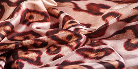 texture, background, pattern. silk fabric, tiger skin, light and silky soft, this atlas charmeuse is perfect for your projects - especially on bias. Colors include tan, black and brown.