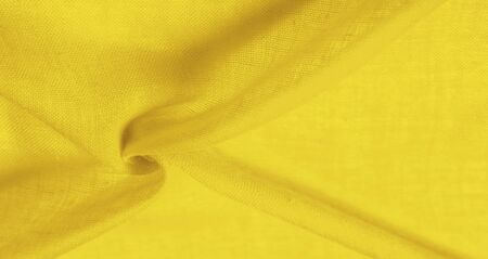 Texture silk fabric, school bus yellow THE BEST IDEAS FOR your projects: elegant and luxurious. There is no need for any special design. Mothers Day wedding anniversary Thanksgiving and more Reklamní fotografie