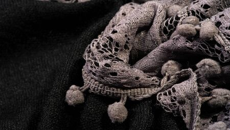 Texture background, female lace scarf. Arrived quickly and beautifully, silver color. The scarf is thin but very attractive and very well made with no loose yarn or loose parts. 스톡 콘텐츠