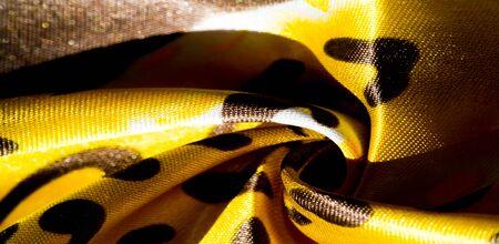 texture, pattern, background. leopard silk fabric. Screen printing on silk duck
