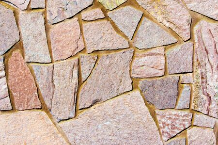 Texture background pattern. Granite stone, sandstone. finishing of buildings fences,  sedimentary rock, consisting of sand or quartz grains, cemented together typically red, yellow, or brown in color 写真素材