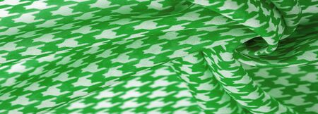Texture, background, pattern, silk fabric, the brightness of green color on a white background.