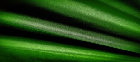 texture, background, pattern. green silk fabric panoramic photo. Silk Duke mood Satin is a beautiful and royal silk fabric.