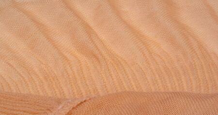 Texture, background, pattern, beige corrugation silk crushed fabric Фото со стока