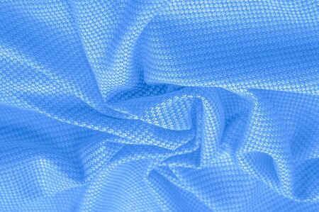 Background texture, pattern Fabric warm wool with stitched blue thread.